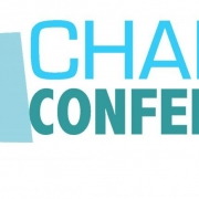 Photo of the words Charge Conference on a white background and multiple colored shapes to the left of the words